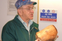 Here I am showing the crowd my intended work piece, a piece of spalted beech that will be a natural edged bowl.