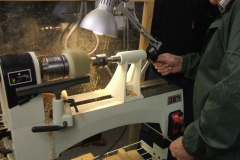 Bob is now working on his 2nd project the candle holder, here he can be seen drilling the hole for the candle.