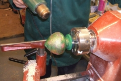 The 3rd of my bourballs, this one had a coat of glitter sprayed over the green base coat, here I'm assisting the drying with a heat gun.
