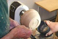 Here Dave is sanding the outside shape, the chuck recess can be seen with some decoration.