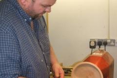Richard sanding the inside of his Elm bowl.