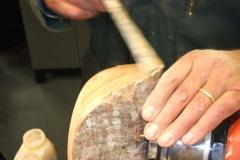 Mark Dale applying sanding sealer to his natural edged bowl.