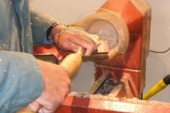Mark Dale working on the inside of his natural edged bowl.