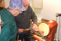 Here we have Bill Henderson making his first cuts on a bowl blank using a bowl gouge, being supervised by myself.