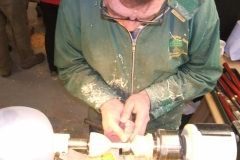 Dave line sanding the stem of the goblet.