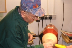 Sanding the chuck by hand where the jaws will sit.