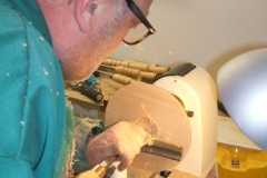 Here Colin can be seen starting the cuts on the inside of his platter, again using tipped tools.