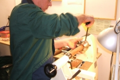 Here we have David Hobson mounting a piece of Mahogany in the chuck to make some finials.