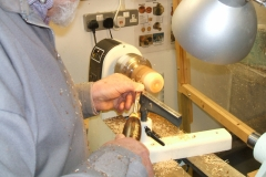 This is Douglas Stewart making a start on one of his 2 fruits, this is an Apple being made from a piece of Yew wood.