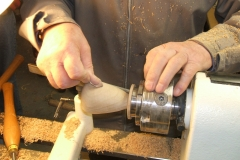 Douglas's Pear being sanded prior to being removed from the lathe and the stalk inserted.