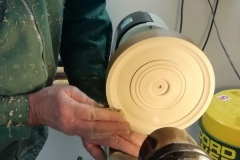 Here John is sanding all the surfaces on the face of his clock.