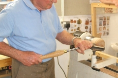 Here we have Bob Chisholm as he starts to make a wooden Orange from a piece of Elm wood.