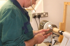 Here we have David Hobson as he starts to make a wooden pear from a piece of Zebrano wood.