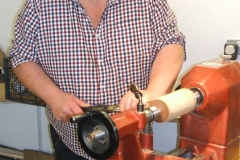 Here we have Richard Comfort as he make a start on making a wooden pear from a piece of Elm wood.