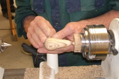 David Hobson's Zebrano pear taking shape, here he can be seen doing the final sanding.