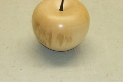 Alec MacLeod's completed apple made from a piece of Sycamore.