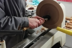 Bill is sanding the inside of his platter.