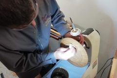 Here David is applying a coat of sanding sealer to the inside of his platter.