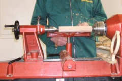 He started with a length of squared Beech and turned it into a cylinder, the speed was about 1200 rpm initially going up to about 1500 rpm .