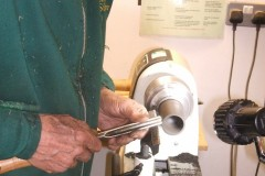 Here Nick is finishing off the top lip of his cup. He went on to make a top for the cup, also threaded.