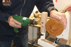 David drilling the hole for the cable using a home made jig to get the hole in the right place.