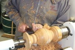 Bill Munro working on the shape of his base with a large gouge.