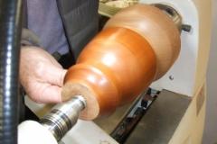 Here Bob Chisholm is sealing and polishing his lamp base.