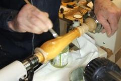David Ross sealing the stem of his lamp.