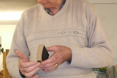 Here John is showing the members part of one of the staves as he got them and described what he had to do.