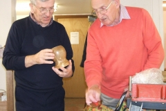 Here we have Bob Chisholm (in the pink jumper) showing one of his entries, a vase shaped candle holder.