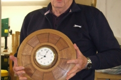 Bill altered the plate and with the inclusion of a ring of Walnut and a clock movement, he turned the plate into a wall clock.