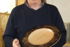 Last of my entries, a shallow plate in Beech with a Laser design rim and scorched finish.