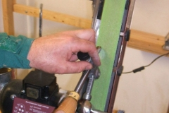David Hay using the sharpening jig to sharpen a bowl gouge.