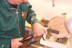Here I am trying a gouge for sharpness after re-grinding and sharpening.