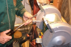 Here I am working on a second bowl gouge using the white wheel to remove some of the wings and also to sharpen.