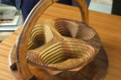 The plate after the handle had been raised turned this flat piece of work into a 3 compartment bowl,