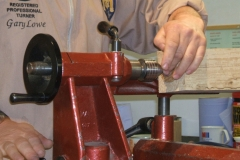 Here Gary is fixing the tailstock, having mounted the other end in the chuck.