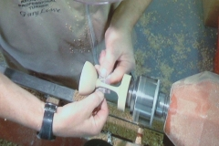This screen shot shows Gary sanding the delacate stem.