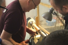 Here David is showing how to use a gouge on end grain with some of the members looking on.