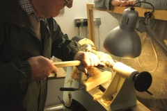 Here Bob is cleaning up the base of his Christmas tree prior to taking it off the lathe.