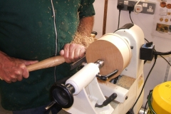 Here Dave is using a bowl gouge to bring the blank to his ideal size.