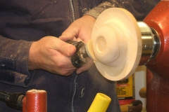 He used a hand held sanding system that worked on friction, progressing through the grades of discs.