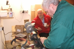 Here we have David Hay at the sharpening station, being observed by some of the members.