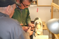 Here Dave line is being supervised on the use of a parting tool to cut the goblet free, Bill Munro is ready to assist if needed.