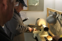 Bill Munro repositioning the tool rest as he comes up the side of his bowl.