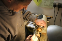 The goblet that David Hutcheson is making nears completion, here he is applying some sealer to his goblet.