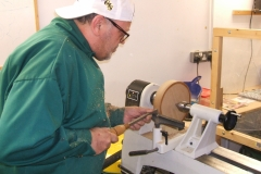 This is Colin MacKenzie making a start on his Elm platter, Colin works a lot with tipped tools.