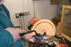This is David Hay using the bowl saver tool on the first of 2 cuts he would do with the tool. the wood David used was a highly spalted piece of Beech.