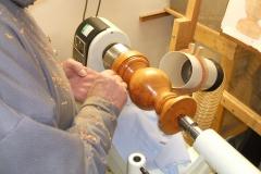 Bill Munro sealing his lamp base, flattening the sealer prior to polishing.
