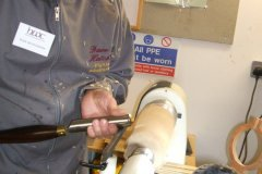 David is using a roughing gouge to bring his blank into a cylinder.